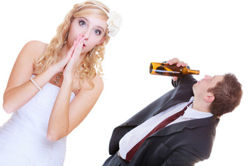 Bride having argument with drunk alcoholic groom