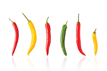 Chili peppers, chillies, red, green, and yellow, isolated on white background with drop shadow.