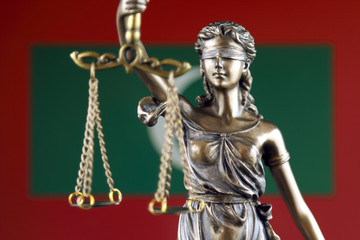 Symbol of law and justice with Maldives Flag. Close up.