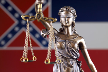 Symbol of law and justice with Mississippi State Flag. Close up.