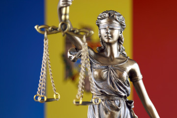 Symbol of law and justice with Moldova Flag. Close up.