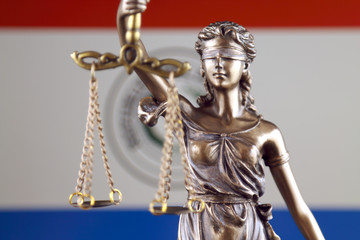 Symbol of law and justice with Paraguay Flag. Close up.