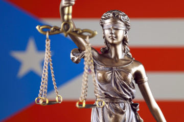 Symbol of law and justice with Puerto Rico Flag. Close up.