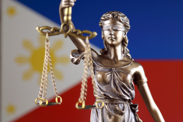 Symbol of law and justice with Philippines Flag. Close up.