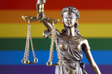 Symbol of law and justice with Rainbow Flag. Close up.