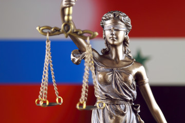 Symbol of law and justice with Russia and Syria Flag. Close up.