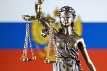 Symbol of law and justice with Russia Flag. Close up.
