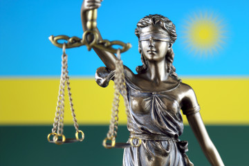 Symbol of law and justice with Rwanda Flag. Close up.