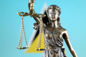 Symbol of law and justice with Saint Lucia Flag. Close up.