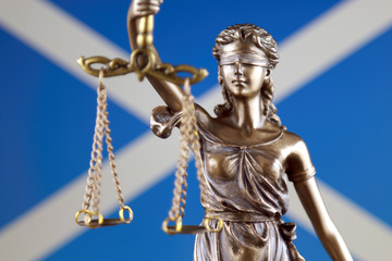 Symbol of law and justice with Scotland Flag. Close up.