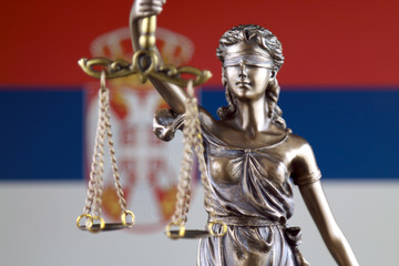 Symbol of law and justice with Serbia Flag. Close up.