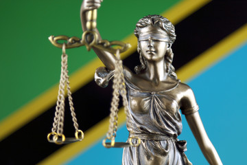 Symbol of law and justice with Tanzania Flag. Close up.