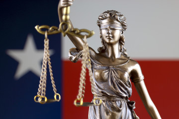 Symbol of law and justice with Texas State Flag. Close up.