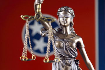 Symbol of law and justice with Tennessee State Flag. Close up.