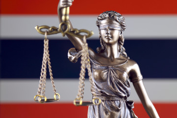 Symbol of law and justice with Thailand Flag. Close up.