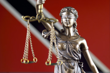 Symbol of law and justice with Trinidad and Tobago Flag. Close up.