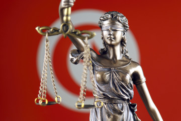 Symbol of law and justice with Tunisia Flag. Close up.