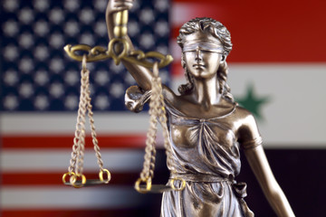 Symbol of law and justice with United States and Syria Flag. Close up.