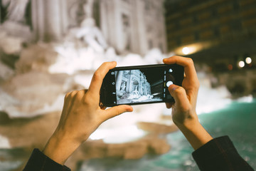 Taking a photo of Trevi Fountain in Rome Italy