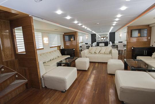 Interior of large salon area of luxury motor yacht