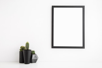 Black photo frame mock up and a cactus.