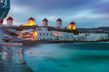 Fototapete - Famous view, Traditional windmills on the island Mykonos, The island of the winds, at cloudy sunrise, Greece