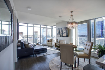 Light filled family room with panoramic view of Seattle