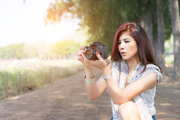 girl taking photo at park outdoor with copy space.