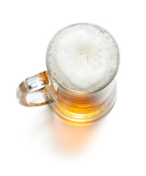 mug of ligt beer with foam isolaed on white background