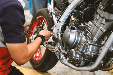motorcycle engine repair with soft-focus and over light in the background Papier Peint