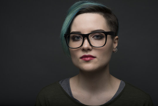 closeup portrait of young short haired woman. lgbt activist