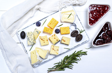 pieces of brie cheese, roquefort, camembert, cheddar