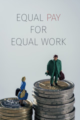 miniature people and text equal pay for equal work
