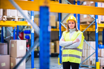 Portrait of a young woman warehouse worker.