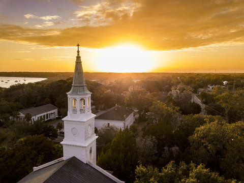 Aerial view of historic church steeple and sunset in Beaufort, South Carolina.
