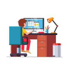 Student boy sitting at desk, doing school homework