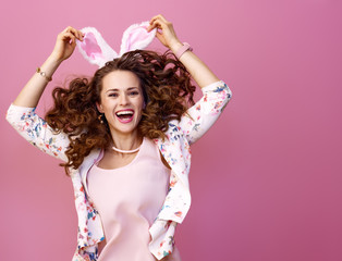 happy modern woman isolated on pink background jumping