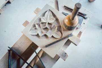Tools and stone ornament in workshop of stonemason