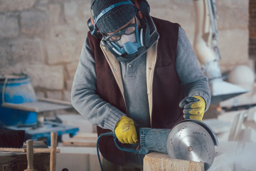 Stonemason with protective clothing working