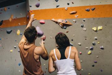Man and woman at an indoor rock climbing gym
