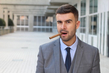Businessman smoking a cigar in office space