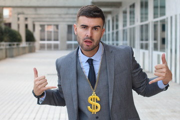 Businessman rocking golden necklace with dollar sign