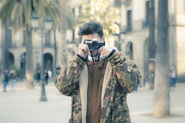 young man with an analog camera at Barcelona