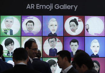 A display of emojis is seen at the Samsung booth at the Mobile World Congress in Barcelona
