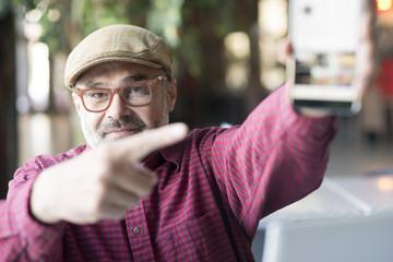 Adult man using smartphone application