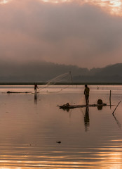 Scenic fisherman silhouette in JOMBOR water dam