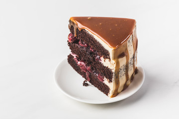 Category & close up view of sweet cherry-chocolate cake on plate isolated on ...