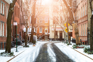 Sunlight shines on snow covered street in Greenwich Village Manhattan New York City