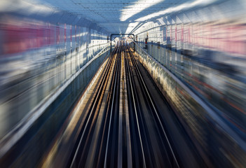 Fast motion zoom effect in a tunnel with train tracks