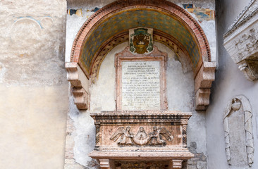 Foto auf Acrylglas Denkmal Sarcophagus of the Abati - Sarcofago degli Abati - on the external façade of the little church of Sant'Apollinare, Trento, Trentino Alto Adige, Italy